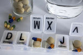 Pills with pill organizer, writing in Spanish — Stockfoto
