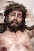 Figure of Jesus on the cross carved in wood by the sculptor Jos — Stockfoto