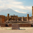 Ancient ruins of Pompei with volcano Vesuvius at back during sunset, Italy — Stock Photo #40972491
