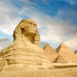 Famouse Sphinx and the great pyramids under interesting evening clouds, Cairo, Egypt — Stock Photo #40977821
