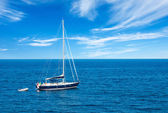 Luxury yatch in open waters with beautiful clouds — Stock Photo