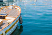 Old style boat on calm ocean in a clear sunny day — Stock Photo