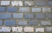 Backgrounds grey cobbled path — Stock Photo