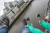 Two pair of foot over Dublin — Stock Photo