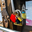 Padlocks on a bridge as a symbol of love — Stock Photo