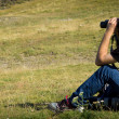 Stock Photo: Mwith binoculars looking at nature