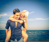 Couples on the beach — Stock Photo