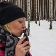 Stock Photo: Sexy russian woman kisses her mobile phone