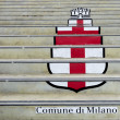 Logo of Milan on the stairs.Street art — Stock Photo