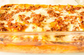 Original italian lasagne on baking dish — Stock Photo