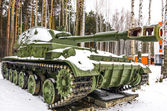 Military tank in a forest — Stock Photo