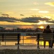 Couple watching the sunset — Stock Photo