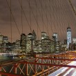New York city night skyline from Brooklyn bridge — Foto Stock