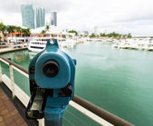 Telescope on Miami skyline — Stock Photo