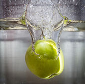 Apple dive in the water — Stock Photo