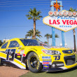 Welcome to Las Vegas sign and Nascar racing car — Stock Photo