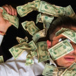 Stock Photo: Business mon floor covered with dollars