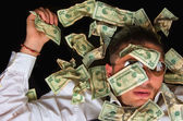 Business man on the floor covered with dollars — Stock Photo