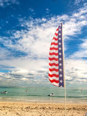 Tropical beach and flag of USA — Stock Photo