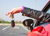 Girl holding car key — Stock Photo
