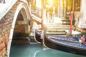 Canal with gondolas in venice — Stock Photo