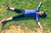 Woman gets rest after long run — Stock Photo