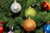 Christmas ornaments on a Christmas tree — Stock Photo