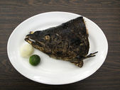 Salted and grilled salmon head — Stock Photo