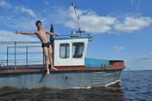 Cheerful boy on a boat — Stock Photo