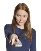 Woman with remote — Stock Photo