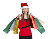 Young shopping woman with Christmas hat — Stock Photo