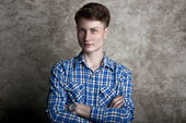 Young man with arms crossed — Foto Stock