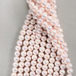 Stock Photo: Twisted strands of pink pearls