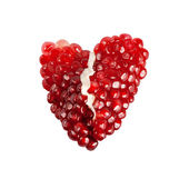 Red broken heart of pomegranate seeds — Stock fotografie
