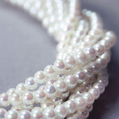 Twisted strands of nacre pearls  — Stock Photo