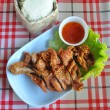 Thai style fried chicken with sticky rice — Stock Photo #41563965