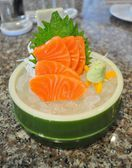 Japanese traditional food - Raw Salmon sashimi on ice in Bamboo  — Stock Photo