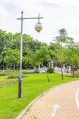 Arrow and Lamp in the park — Stock Photo
