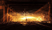 Man Spinning the Burning Steel Wool At Night — Stock Photo
