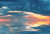 Sky on sunset or sunrise with clouds and  reflection in water,na — Stock Photo