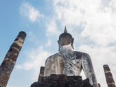 Back of big image of Buddha in Thailand — Stock Photo