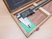Metal vernier caliper in wooden box package — Stock Photo