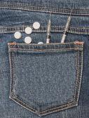 Syringe and pills on jean pocket — Stock Photo