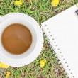 Cream notebook with pen and cup of coffee — Stock Photo