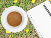 Cream notebook with pen and cup of coffee — Stock fotografie