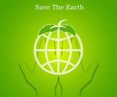 Hand, die eine abstrakte grüne Erde — Stockfoto