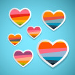 Colorful Abstract Hearts Set on Blue Background — Stock Vector #38557773
