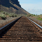Постер, плакат: Train tracks vanishing point