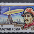 HUNGARY - CIRCA 1977: A Stamp printed in HUNGARY shows a Brazilian aviation pioneer Alberto Santos-Dumont and his dirigible over Eiffel Tower in Paris, circa 1977 — Stock Photo #35427485