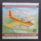 MONGOLIA - CIRCA 1980: A stamp printed in MONGOLIA commemorates World Acrobatic Championship in Oshkosh in Wisconsin and it shows an American aircraft Grumman A-1 Yankee, circa 1980. — Stock Photo